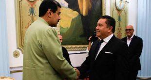 Nicolás Maduro y Javier Bertucci.